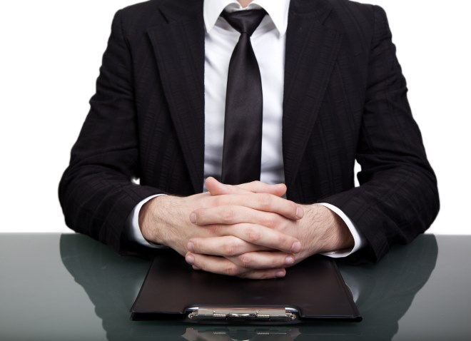 Businessman-hands-clasped